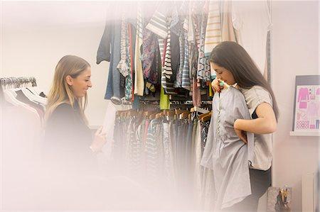 Fashion buyers examining clothing Stock Photo - Premium Royalty-Free, Code: 6124-08703805