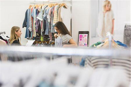 fashion - Fashion buyers examining clothing Stock Photo - Premium Royalty-Free, Code: 6124-08703819