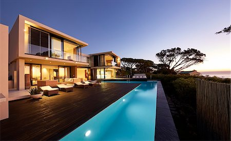 Modern luxury home showcase deck and swimming pool at sunset Stock Photo - Premium Royalty-Free, Code: 6124-08704025