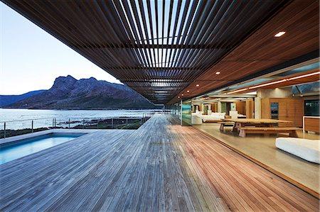 Modern luxury wood patio with ocean view Stock Photo - Premium Royalty-Free, Code: 6124-08704029
