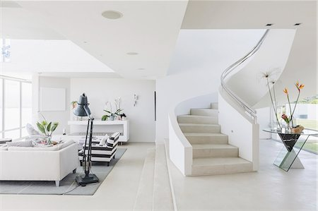 White modern luxury home showcase spiral staircase and living room Stock Photo - Premium Royalty-Free, Code: 6124-08908208