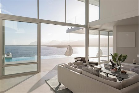design - Sunny, tranquil modern luxury home showcase interior living room with ocean view Stock Photo - Premium Royalty-Free, Code: 6124-08908228