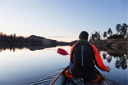 Sweden, Medelpad, Nolby, Man canoeing at dawn Stock Photo - Premium Royalty-Free, Code: 6126-08642962