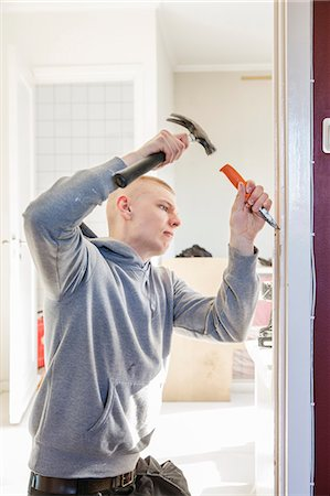 skinhead - Sweden, Young man renovating house Stock Photo - Premium Royalty-Free, Code: 6126-08643010