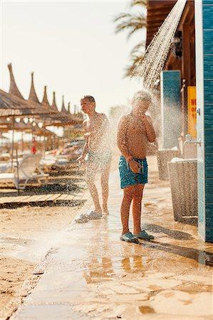 preteen shower pic - Turkey, Alanya, Boy (10-11) and girl (8-9) standing under shower on beach Stock Photo - Premium Royalty-Free, Code: 6126-08643277