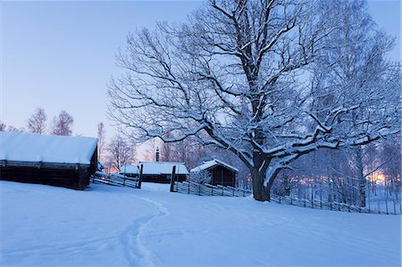 Sweden, Dalarna, Mora, Wooden houses covered with snow Stock Photo - Premium Royalty-Free, Code: 6126-08643376