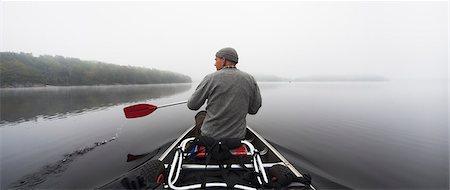 fog (weather) - Sweden, Blekinge, Lake Halen, Man rowing on lake Stock Photo - Premium Royalty-Free, Code: 6126-08643505