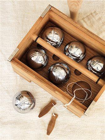 silver box - Sweden, Vastergotland, Petanque set in wooden container Stock Photo - Premium Royalty-Free, Code: 6126-08643778