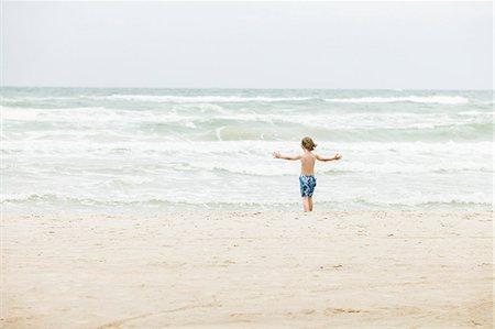 preteen boy shirtless - Denmark, Vendsyssel, Jutland, Lokken, Boy (8-9) standing on beach Stock Photo - Premium Royalty-Free, Code: 6126-08643793