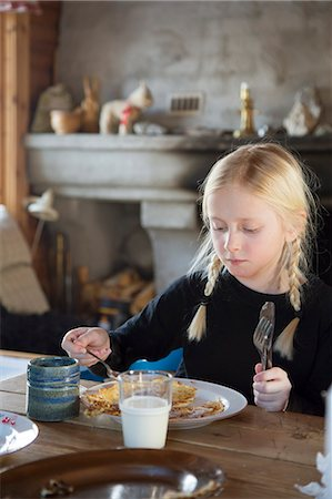 Norway, Girl (10-11) eating pancakes for breakfast Stock Photo - Premium Royalty-Free, Code: 6126-08643856
