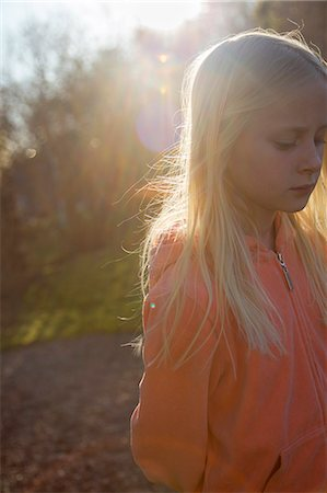 Sweden, Vastergotland, Lerum, Girl (10-11) in sunlight Stock Photo - Premium Royalty-Free, Code: 6126-08643861