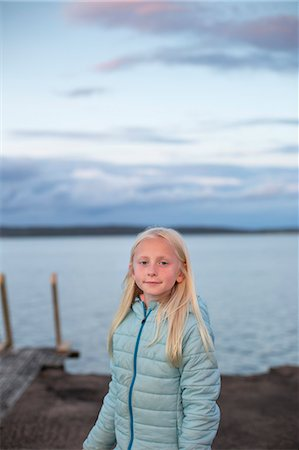 Sweden, Halland, Onsala, Portrait of girl (10-11) in front of lake Stock Photo - Premium Royalty-Free, Code: 6126-08643882