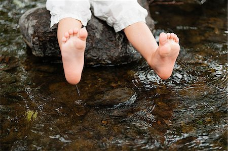 Sweden, Vastmanland, Baby boy (18-23 months) dipping feet in water Stock Photo - Premium Royalty-Free, Code: 6126-08643998