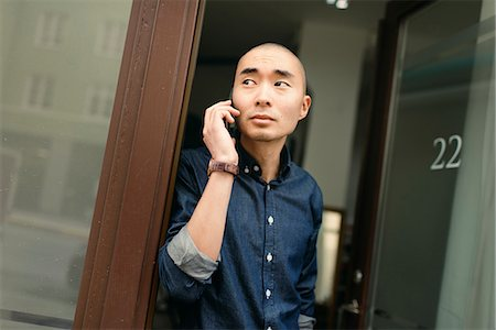 skinhead - Sweden, Young man on the phone Stock Photo - Premium Royalty-Free, Code: 6126-08644044