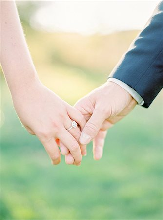 Sweden, Close-up of holding hands of newlyweds Stock Photo - Premium Royalty-Free, Code: 6126-08644295
