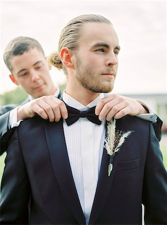 Sweden, Groom adjusting partner's bow tie at gay wedding Stock Photo - Premium Royalty-Free, Code: 6126-08644305
