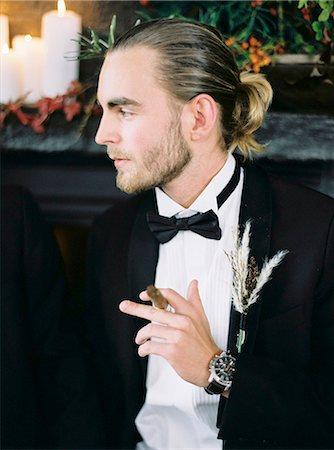 Sweden, Man holding cigar Stock Photo - Premium Royalty-Free, Code: 6126-08644312