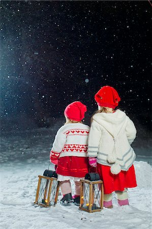 Finland, Sisters (12-17 months, 2-3) standing in backyard at night Stock Photo - Premium Royalty-Free, Code: 6126-08644727