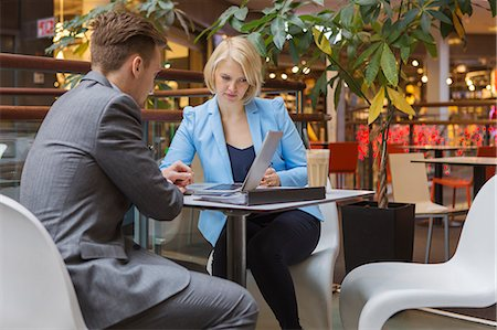 Finland, Helsinki, Businessman and businesswoman in cafe Stock Photo - Premium Royalty-Free, Code: 6126-08644893