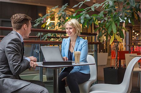 Finland, Helsinki, Businessman and businesswoman in cafe Stock Photo - Premium Royalty-Free, Code: 6126-08644892