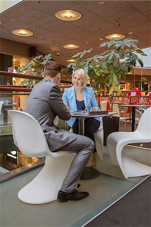 Finland, Helsinki, Businessman and businesswoman in cafe Stock Photo - Premium Royalty-Free, Code: 6126-08644894