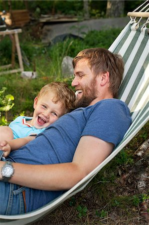Sweden, Father and son (2-3) in hammock Stock Photo - Premium Royalty-Free, Code: 6126-08658951