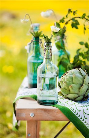 Sweden, Uppland, Flower in bottle and artichoke on table Stock Photo - Premium Royalty-Free, Code: 6126-08658959