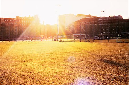 Sweden, Vastra Gotaland, Gothenburg, Heden, Playing field at sunset Stock Photo - Premium Royalty-Free, Code: 6126-08658922