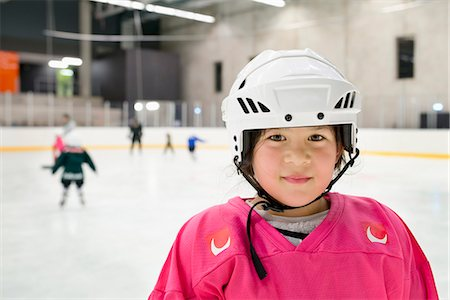 Sweden, Portrait of girl (6-7) in ice hockey uniform Stock Photo - Premium Royalty-Free, Code: 6126-08659028