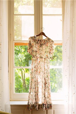 France, Dress hanging in window Stock Photo - Premium Royalty-Free, Code: 6126-08659293