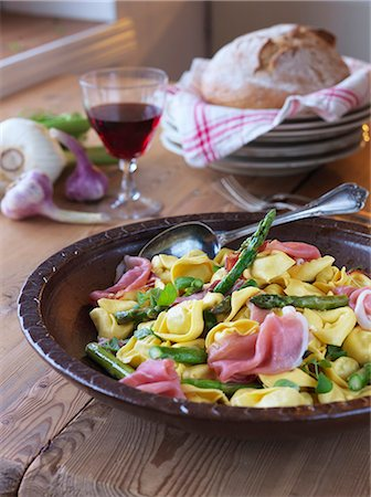 Sweden, Tortellini with asparagus and parma ham Stock Photo - Premium Royalty-Free, Code: 6126-08659408