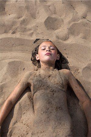 Sweden, Dalarna, Girl (10-11) lying in sand on beach Stock Photo - Premium Royalty-Free, Code: 6126-08635074