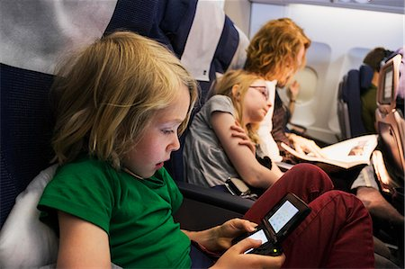 Sweden, Mother travelling by plane with children (6-7, 10-11) Stock Photo - Premium Royalty-Free, Code: 6126-08635128