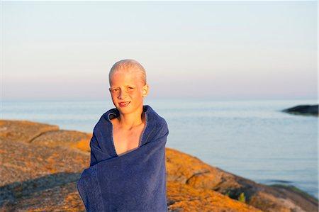 Sweden, Sodermanland, Stockholm Archipelago, Varmdo, Portrait of boy (12-13) wrapped in towel on beach Stock Photo - Premium Royalty-Free, Code: 6126-08635301