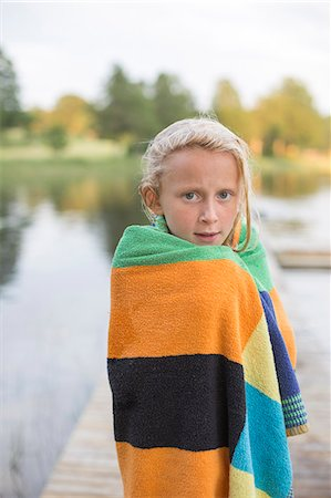 Sweden, Smaland, Braarpasjon, Portrait of girl (10-11) wrapped in towel after swimming in lake Stock Photo - Premium Royalty-Free, Code: 6126-08636056