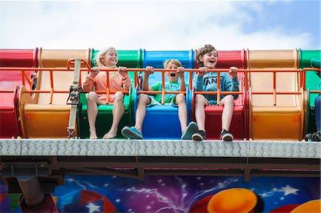 front row seat - Sweden, Skane, Simrishamn, Excited children (10-11, 12-13) in amusement park Stock Photo - Premium Royalty-Free, Code: 6126-08636078