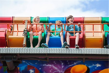 Sweden, Skane, Simrishamn, Excited children (10-11, 12-13) in amusement park Stock Photo - Premium Royalty-Free, Code: 6126-08636078