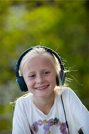 Sweden, Vastergotland, Portrait of girl (10-11) wearing headphones Stock Photo - Premium Royalty-Free, Code: 6126-08636033