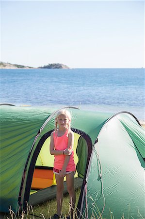 Sweden, Swedish West Coast, Halland, Kungsbackafjorden, Girl (10-11) standing in front of tent Stock Photo - Premium Royalty-Free, Code: 6126-08636037
