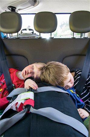 Boys (2-3, 4-5) sleeping in car Stock Photo - Premium Royalty-Free, Code: 6126-08636613