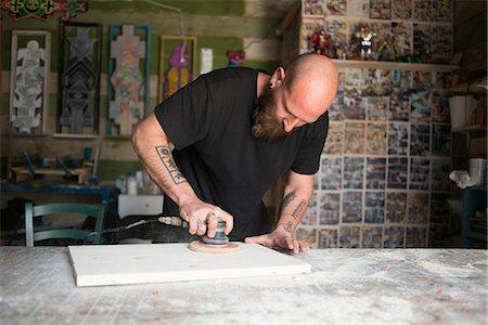 skinhead - Israel, Man polishing wood in workshop Stock Photo - Premium Royalty-Free, Code: 6126-08781356