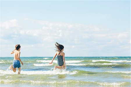 preteen girl wet clothes - Sweden, Oland, Kopingsvik, Girl (10-11) and boy (8-9) running into sea Stock Photo - Premium Royalty-Free, Code: 6126-08781415