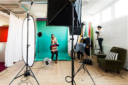 Fashion models getting dressed while assistants working in studio Stock Photo - Premium Royalty-Free, Code: 6127-08667286