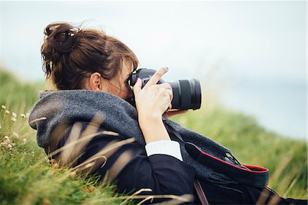 female - Side view of woman photographing through SLR camera on hill Stock Photo - Premium Royalty-Free, Code: 6127-08687720