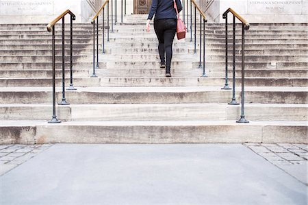 Low section of woman climbing New York Public Library's staircase Stock Photo - Premium Royalty-Free, Code: 6127-08704256