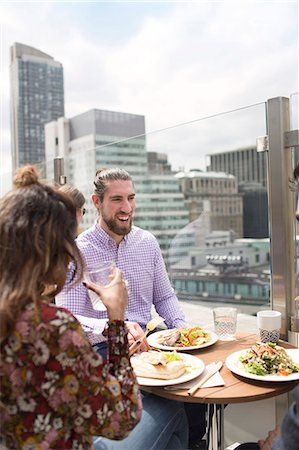 restaurant new york manhattan - Friends enjoying meal at rooftop restaurant in city Stock Photo - Premium Royalty-Free, Code: 6127-08704359