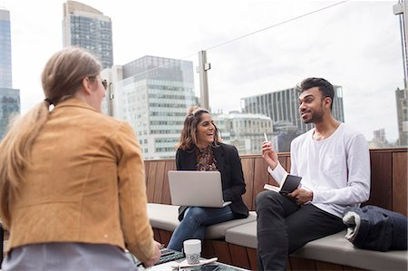 restaurant new york manhattan - Business people discussing while relaxing at rooftop restaurant Stock Photo - Premium Royalty-Free, Code: 6127-08704381