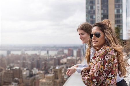 restaurant new york manhattan - Friends looking at city view while standing at rooftop restaurant Stock Photo - Premium Royalty-Free, Code: 6127-08704387