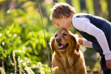 dog kissing girl - Girl kissing dog on the head Stock Photo - Premium Royalty-Free, Code: 6128-08747593