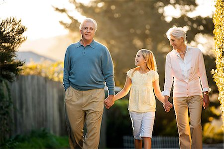 preteens pictures older men - Mature couple walking hand in hand with their young granddaughter. Stock Photo - Premium Royalty-Free, Code: 6128-08747741